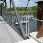 bike trail crosses bridge over boat