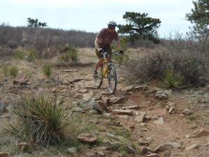 mountain bike rider on Eagle Wind Trail in Colorado